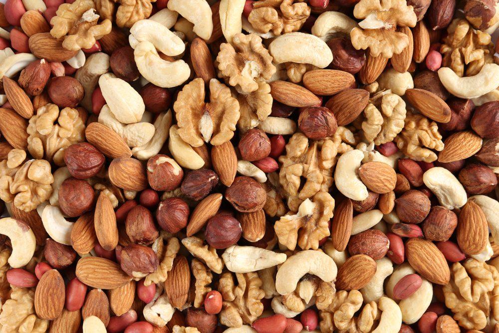 Peanuts, walnuts, almonds, hazelnuts and cashews forming a nuts background