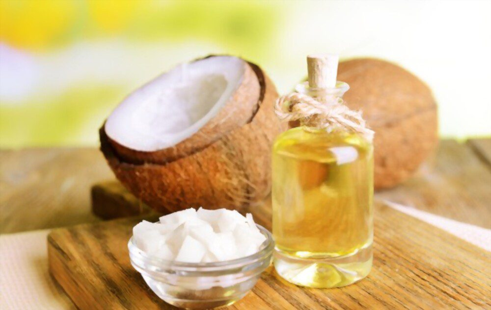 Coconut oil and coconut are on an old table that may cause Coconut oil allergy in some peoples.