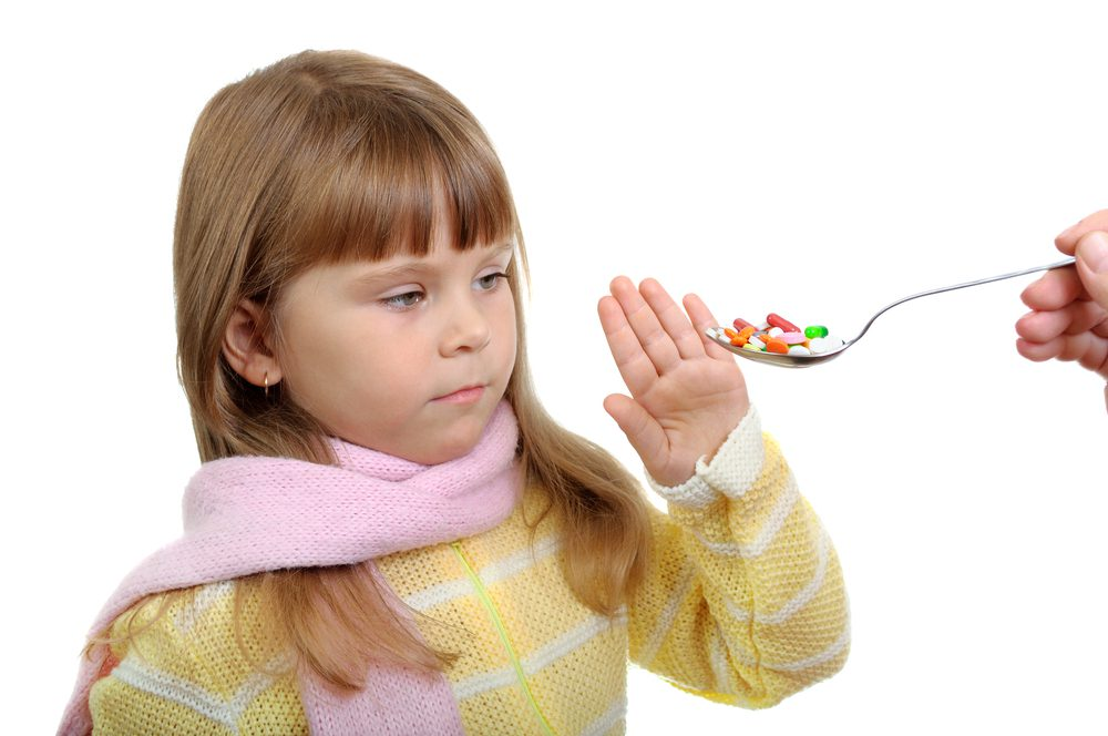 The Child does not want to accept the pills.