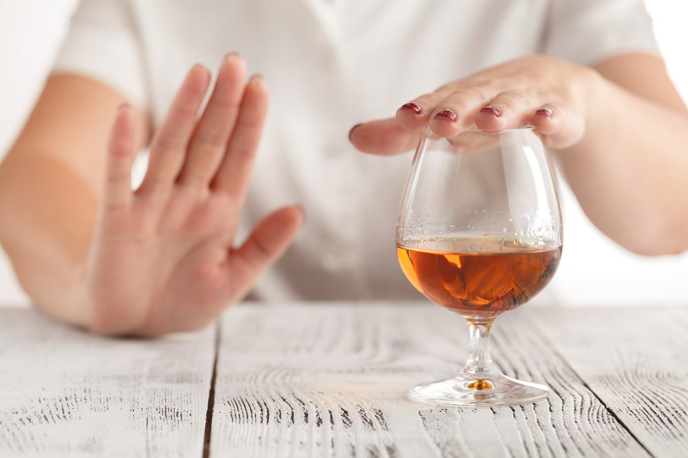Women is suffering with Alcohol Allergy and refuses to drink a alcohol.